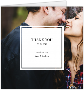 A square wedding thank you card with a prominent white text box on top of a full page photo of a married couple.