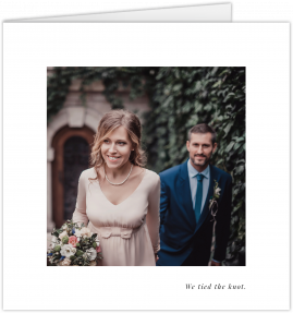 A simple wedding thank you card with a white border and a small personalised message in the bottom left. There is a photo in the middle.